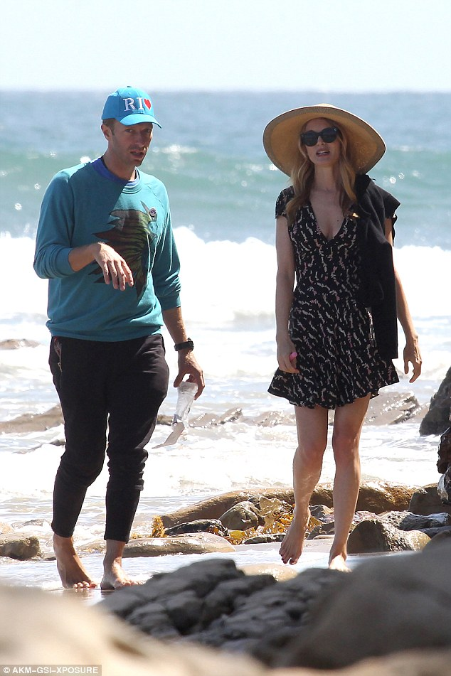 Chris Martin and new girlfriend Annabelle Wallis go for a romantic stroll on the beach together on a sunny Sunday